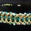 Swarovski arany-cirkon flat spiral karkötő, Ékszer, óra, Karkötő, Ékszerkészítés, Gyöngyfűzés, Ez a karkötő Swarovski bicone-ok és Toho gyöngyök felhasználásával készült. A középső blue zirkon kr..., Meska