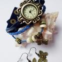 Kék pillangó karóra/ékszeróra , Ékszer, óra, Karkötő, Karóra, óra, Különleges óra réz színű foglalatban sötétkék színű bőr szíjjal és fa gyöngyökkel. A bőrszíj patentt..., Meska