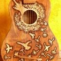 Ukulele méretű gitár, Mindenmás, Baba-mama-gyerek, Hangszer, zene, Gyerekszoba, Famegmunkálás, Kisméretű gyerekgitár gravírozott, égetett mintával. Ideális dekorációnak vagy gyermekhangszernek. ..., Meska