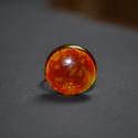 Láva gyűrű, Ékszer, óra, Gyűrű, Üvegművészet, A gyűrű feje kb. 2 cm átmérőjű,   narancs és citromsárga mintázatú, egyedileg festett. A gyűrű ezüs..., Meska