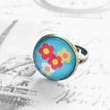 Tavaszi virágos gyűrű, Ékszer, óra, Gyűrű, Állítható méretű, antik réz színű kék virágos gyűrű.  A gyűrű fejének átmérője 2 cm.  ..., Meska