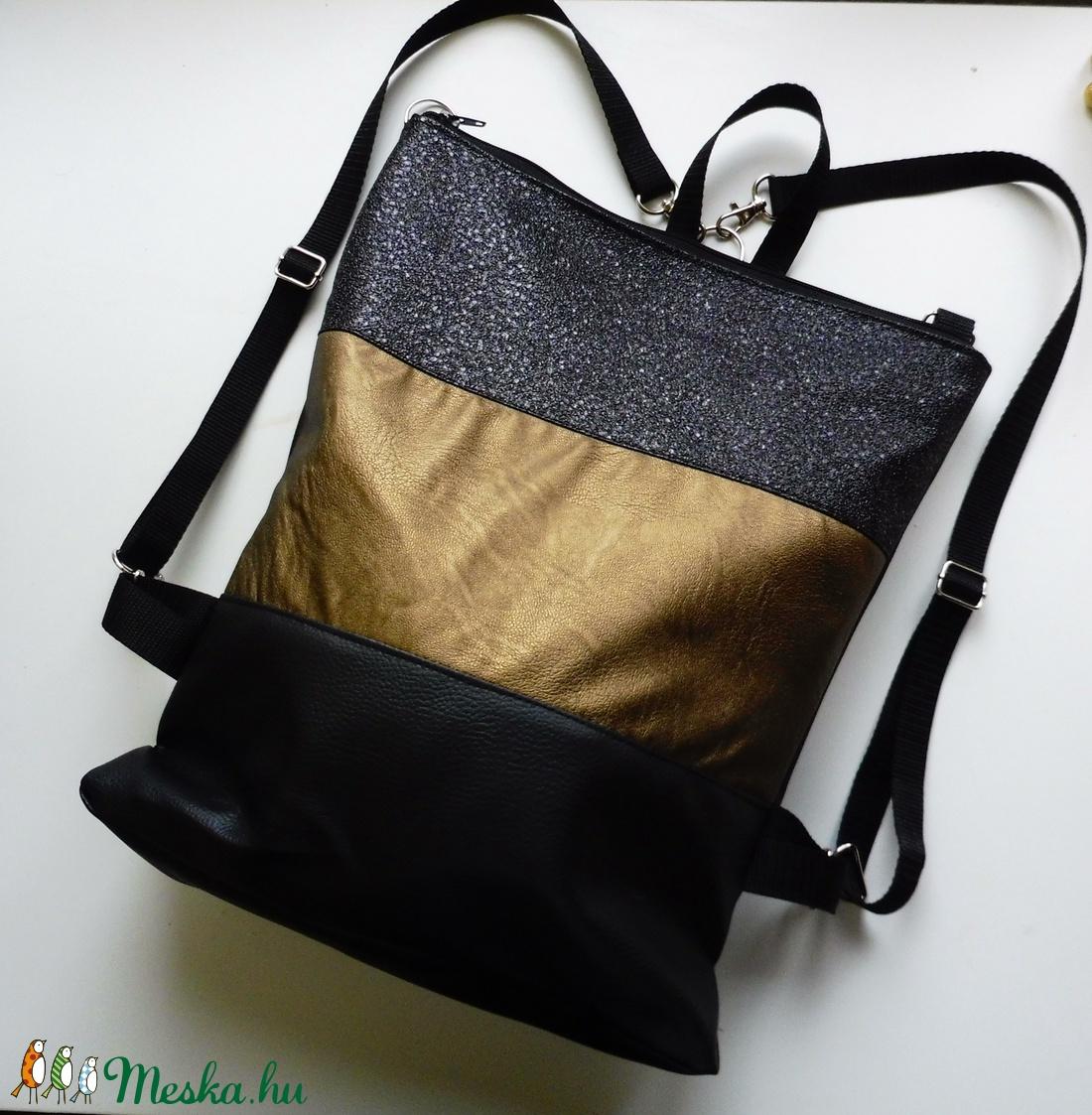 Fekete és arany hátizsák és válltáska