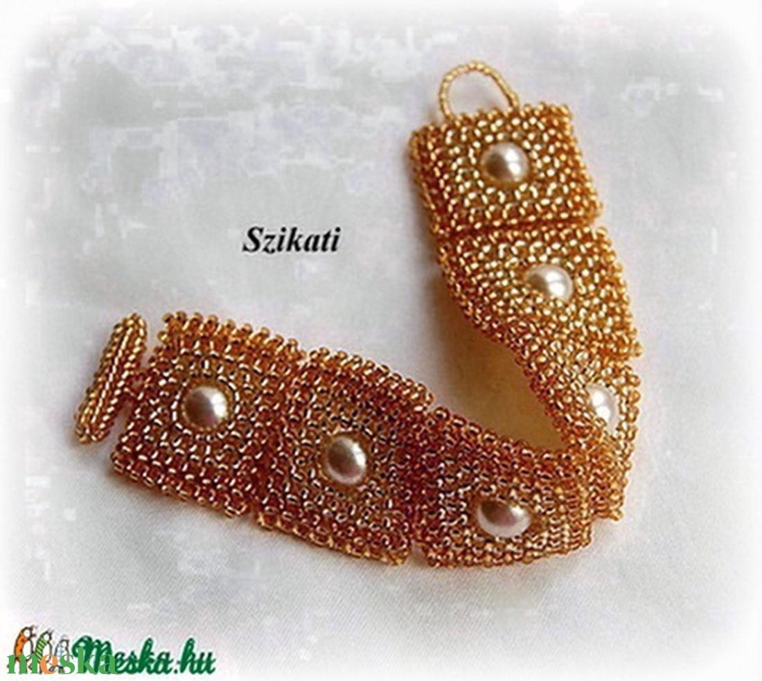 Arany gyöngyfűzött karkötő tekla gyönggyel - ékszer - karkötő - gyöngyös karkötő - Meska.hu