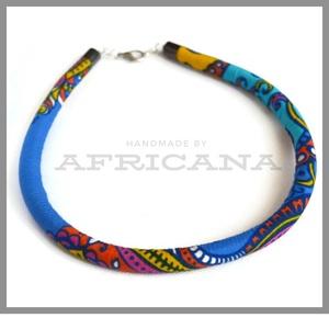 Afrikai stílusú kötélékszer, nyaklánc, autentikus afrikai textiliából, Ékszer, Nyaklánc, Ékszerkészítés, Varrás, Autentikus afrikai pamut textiliával vontam be 0,8 cm vastag szintetikus kötelet. Az anyag mintája, ..., Meska