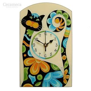 Hímes macska falióra, Lakberendezés, Otthon & lakás, Falióra, óra, Gyerek & játék, Gyerekszoba, Festett tárgyak, Üvegművészet, Üvegre festett egyedi készítésű falióra.\nHímes macskának neveztem el. Bohókás formáját és vidám szín..., Meska
