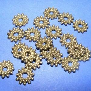 Bronz köztes (539/1. minta/10 db), Gyöngy, ékszerkellék,  Bronz köztes (539/1. minta)  Mérete: 9 mmA lyuk mérete: 2,5 mm  Az ár 10 darab termékre vonatkozik...., Meska