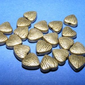 Köztes (694. minta/1 db) - szív, Gyöngy, ékszerkellék,  Bronz köztes (694. minta) - szív  Mérete: 7x7,5x3 mm Az ár 1 db termékre vonatkozik.   , Meska