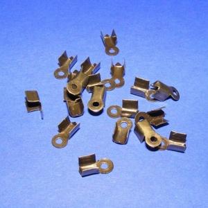 Bőrvég (430/A minta/1 db) - 9x4 mm, Gyöngy, ékszerkellék, Ékszerkészítés, \nBőrvég (430/A minta) -  antik bronz színben\n\n\r\nMérete: 9x4 mm Befogó rész: 4x4x3,5 mm\r\nA furat mére..., Meska