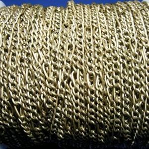 Bronz színű lánc (49. minta/1 m) - 4x8x0,8 mm, Gyöngy, ékszerkellék,  Bronz színű lánc (49. minta)  A nagyobb szem mérete: 4x8 mmA kisebb szem mérete: 3,5x4,5 mmA huzal ..., Meska