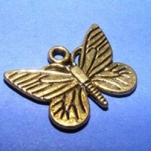 Medál (620. minta/1 db) - pillangó (csimbo) - Meska.hu