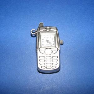 Ékszeróra (mobiltelefon minta/1 db), Órakészítés, Mindenmás, \nÉkszeróra - mobiltelefon formájú - ezüst színben\n\nMéret: 4,5x3 cm\r\nAz ár 1 db órára vonatkozik (ele..., Meska
