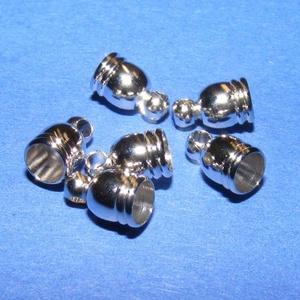 Bőrvég (51. minta/1 db) - 8x5 mm, Gyöngy, ékszerkellék,  Fém bőrvég és szalagvég (51. minta) - platinum színben  Mérete: 8x5 mm Belső átmérő: 4 mm    Az ár ..., Meska