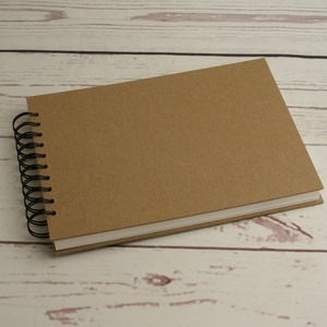 A4-es, fekvő formájú, kemény borítós díszíthető album, fotóalbum. Spirálozott fényképalbum, natúr csomagolópapír borítás, Papír írószer, Otthon & Lakás, Album & Fotóalbum, Könyvkötés, A4-es, fekvő formájú, kemény borítós díszíthető album, fotóalbum. Spirálozott fényképalbum, natúr cs..., Meska