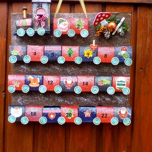 Vonatos naptár, Otthon & Lakás, Dekoráció, Papírművészet, Saját elképzelés alapján készült naptár.Anyaga kartonpapír.\n38x30-as alapra ragasztottam a kis vagon..., Meska