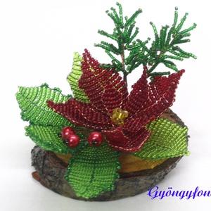 Piros mikulásvirág karácsonyi asztaldísz, Karácsony & Mikulás, Karácsonyi dekoráció, Gyöngyfűzés, gyöngyhímzés, Virágkötés, A díszt ovális alakú fa talpra készítettem. A talp 9 cm hosszú és 7 cm széles. Áll 1 db piros mikulá..., Meska
