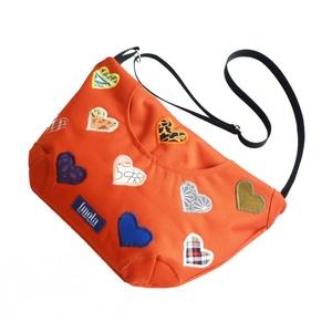 Pluto narancssárga szíves kis táska, Biciklis táska, Biciklis & Sporttáska, Táska & Tok, Varrás, Pluto narancssárga szíves kis táska, állítható pánttal. Bélésén egy osztott zseb, elején egy mágnesz..., Meska