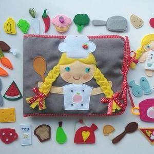 Főzőcske könyvecske rengeteg pakolászni -főzni valóval és cuki kis kuktával! (RENDELHETŐ!), Gyerek & játék, Játék, Készségfejlesztő játék, Baba, babaház, Varrás, Saját, egyedi tervezésű minta alapján készült vidám, színes textilkönyv, melynek témája a sütés-főzé..., Meska