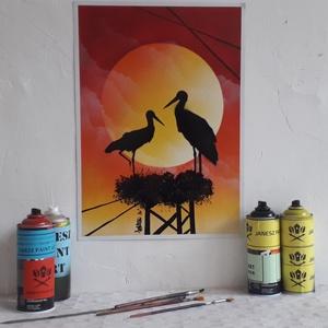Gólyapár festmény - festékszóróval készült, Otthon & lakás, Képzőművészet, Festmény, Festmény vegyes technika, Festészet,  Festményemet fényes kartonra készítettem. Egy naplementét ábrázol a fészkükben álló gólyapár szilue..., Meska