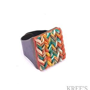 """Narancs kötött mintás gyűrű, Statement gyűrű, Gyűrű, Ékszer, Ékszerkészítés, Gyurma, Süthető gyurmából készítettem ezt az egyedi, \""""kötött\"""" mintás gyűrűt.\nA gyűrű tányérja kb.1,8x2 cm, a..., Meska"""