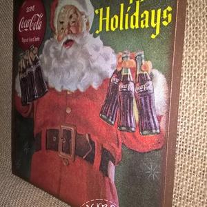 Karácsonyi falikép - Coca-cola Mikulás, Dekoráció, Otthon & lakás, Ünnepi dekoráció, Karácsony, Decoupage, transzfer és szalvétatechnika, 16*16-os mdf lapra készült decoupage technikával.\nAz éleket bronz viaszpasztával kentem át (ez a kép..., Meska