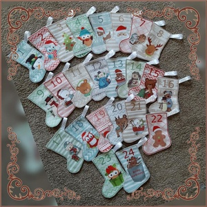 Adventi kiscsizmák 24db, Otthon & Lakás, Karácsony & Mikulás, Adventi naptár, Varrás, Szivből ajánlom Adventi kiscsizmáimat,mely az ünnep közelettét boldoggá teszi gyermekednek.\nMéretük ..., Meska