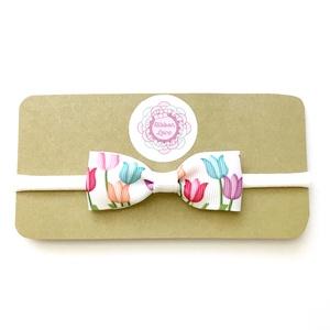 Tulipán virágos masnis puha rugalmas fejpánt, hajpánt, Táska, Divat & Szépség, Hajbavaló, Ruha, divat, Gyerek & játék, Hajpánt, Varrás, Ékszerkészítés, A masnit tulipán virág mintájú szalagból készítettem!\n\nA fejpánt szélessége: 5 mm.\nA masni mérete: k..., Meska