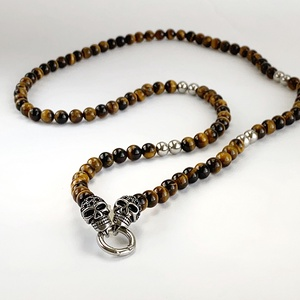 Tigrisszem-nemesacél koponyás nyaklánc, Ékszer, Nyaklánc, Férfiaknak, Gyöngyfűzés, gyöngyhímzés, Tigrisszem 10 mm-es ásványgyöngyökből készült nyaklánc. A tigrisszem ásványt  nemesacél ezüst színű ..., Meska