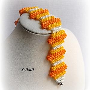 Fehér/sárga/narancs gyöngyfűzött karkötő (szikati) - Meska.hu