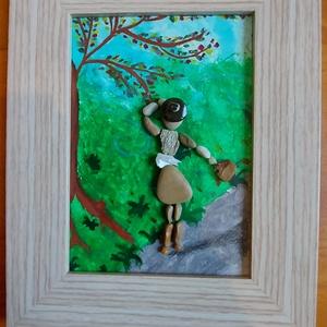 Séta a szélben kavicskép, Otthon & Lakás, Dekoráció, Kavics & Kő, Mozaik, Festészet, Kavicsok felragasztásával készült egyedi kép akrillal festet háttérrel. Egy sétáló nőt ábrázol táská..., Meska