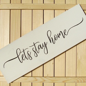 Lets stay home 60x20 cm fa tábla, Otthon & lakás, Dekoráció, Kép, Lakberendezés, Falikép, Famegmunkálás, Festett tárgyak, Kézzel készített fa tábla:\n\nalap: fenyő,\nfehér háttérfestés,\nfekete betűk.\n\n(barna fenyő keret külön..., Meska