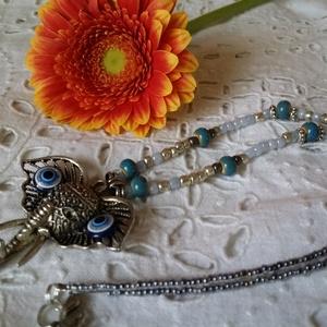 Elefánt medálos nyaklánc, Ékszer, Nyaklánc, Medálos nyaklánc, Ékszerkészítés, Gyöngyfűzés, gyöngyhímzés, Tibeti elefántos medállal díszített nyaklánc. A kerámia gyöngyök kiegészítik az ezüst-kék medált...\n..., Meska