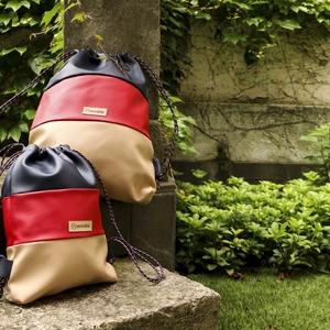 Anya-lánya hátizsák (gymbag), A két táska kívülről teljesen megegyező, de különböző anyaggal bélelt.\nA felnőtt táskában két kisebb..., Meska
