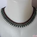 Piros, fehér, zöld fűzött gyöngy nyaklánc, Ékszer, óra, Nyaklánc, Fekete alapon piros-fehér-zöld díszítéssel fűzött nyaklánc. Hossza 41 cm, szélessége 1,8 c..., Meska