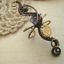 Steampunk fülgyűrű - Alkonyat, Ékszer, Fülbevaló, Steampunk fülgyűrű sárgaréz és vörösréz drótból, fogaskerékből és lila swarovski gyöngyből.  A fülgy..., Meska