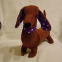 Tacsi - Zsömle Mester - tacskó kutya, Zsömle egy kis önérzetes tacskó kutya, aki sze...