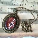 A zene a mindenem gyanta nyakék, Ékszer, Képzőművészet, Nyaklánc, Medál, Kottával és egy violinkulccsal díszített gyanta ékszert készítettem, amit egy bronz medál alapba önt..., Meska