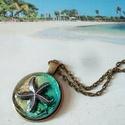 A tengeri csillag gyanta nyakék, Ékszer, Képzőművészet, Nyaklánc, Medál, ezüsz színű fém tengeri csillaggal díszített gyanta ékszert készítettem, amit egy bronz medál alapba..., Meska