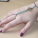 Kínai-csomó, türkizkék réz karkötő-gyűrű (kézfejkarkötő), Ékszer, Karkötő, Gyűrű, Elkészítettem a kínai-csomó mintás változatát az újfata karkötő-gyűrűnek (kézfejkarkötőt), ezúttal t..., Meska