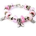 Koriszezon! - halvány rózsaszín téli charm karkötő pandora stílusban korcsolyával, Ékszer, Karkötő, Többféle rózsaszín mintás pandora lámpagyöngyből, rózsaszín csiszolt üveg pandora stílus..., Meska
