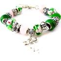 Tavaszváró! - zöld és rózsaszín virágos charm karkötő pandora stílusban masnival, Ékszer, Karkötő, Zöld alapon rózsaszín virágos, valamint zöld alapon fekete és bronz cirkás pandora lámpagyö..., Meska