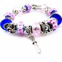 A királylány, a sárkány és a lovag :) - meseszép rózsaszín és kék virágos charm karkötő pandora stílusban sárkánnyal, Ékszer, Karkötő, Sötétkék alapon rózsaszín virág mintás pandora lámpagyöngyből, sötétkék sima üveg, val..., Meska