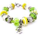 Limonádé! - cirtomsárga és zöld nyári charm karkötő pandora stílusban hibiszkusszal, Ékszer, Karkötő, Különböző citromsárga, valamint sárga alapon zöld és fehér csíkos pandora lámpagyöngyök..., Meska