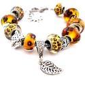 Csui! - leopárd mintás afrikai charm karkötő pandora stílusban párduccal, Ékszer, Karkötő, Sárga alapon barna csíkos, pöttyös és virág mintás pandora lámpagyöngyökből és leopárd ..., Meska