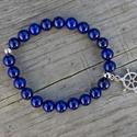 Egység - lapis lazuli karkötő, Ékszer, Karkötő, Lapis lazuli karkötő hajókormány medállal.  Ez a kő gyorsan oldja a stresszt, mély békességet biztos..., Meska