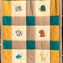 Állatos takaró okker, petrol és drapp színben