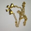 arany masni nyaklánc, Ékszer, Nyaklánc, Kedves kis arany masnit ábrázoló medállal készült arany színű nyaklánc. Hossza 46 cm, Meska