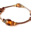 Narancs - bronz karkötő, Ékszer, Karkötő, Erős, dupla gumidamil szálra fűztem; üveg és fém gyöngyöket.  Hossza 16.5 cm., Meska