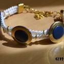 Lefoglalva Eszternek Tengeri elegancia  karkötő, Egyszerű arany-kék gombokkal és arany karikákk...