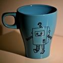 Kék robotos bögrék, Konyhafelszerelés, Bögre, csésze, Festett tárgyak, Kék kerámia bögréket fekete porcelánfestékkel díszítettem. Kettő különböző robotos pohár közül lehe..., Meska