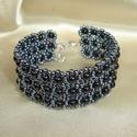 Fekete-hematit széles gyöngy karkötő, Fényes fekete kerek gyöngyökből és hematit sz...